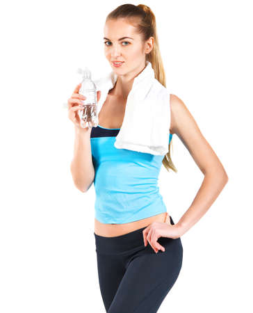 hands on hips: Attractive sporty woman with water and towel on white  Stock Photo