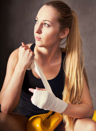 tough girl: Portrait of a woman boxer wearing white strap on wrist