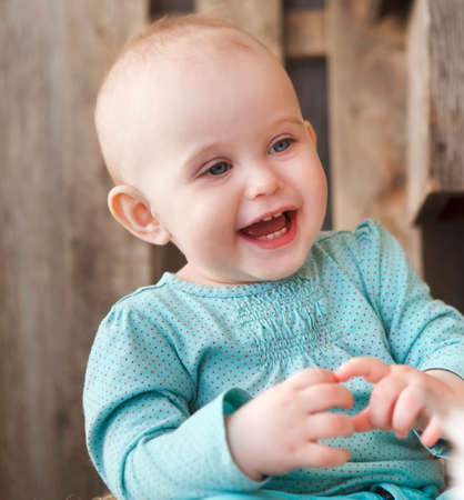 10 month: Cute smiling ten month old baby on the wooden background Stock Photo