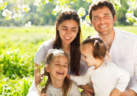 Happy young family with two children outdoors. Spring day Stock Photo - 27785364