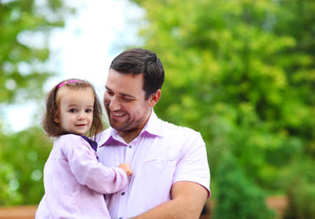 Happy young father with little baby daughter outdoors Stock Photo - 28062908