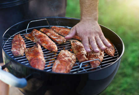 staycation: Fish fillets on the grill with flames in horizontal orientation Stock Photo