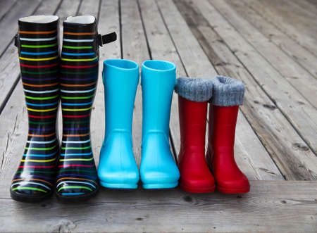Three pairs of a colorful rain boots. Family concept