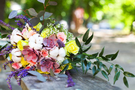 bridal bouquet: Wedding bouquet with succulent flowers and cotton in retro style outdoors. Close up Stock Photo