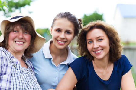 Grandmother with daughter and granddaughter on the farm. Female family portrait photo