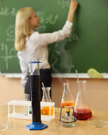 burner: Chemistry laboratory glassware with liquid formula at the classroom Stock Photo