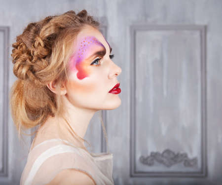 eyeshades: Portrait of a young model beautiful woman with perfect butterfly make up and hairstyle