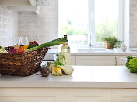 Classical white kitchen at home with healthy food photo