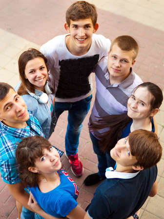 freshmen: Group of smiling teenagers standing outdoors. Friendship concept