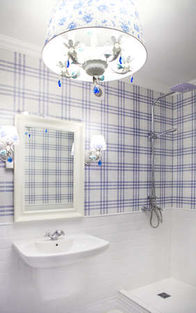 Beautiful blue and white bathroom with shower with copy spase photo