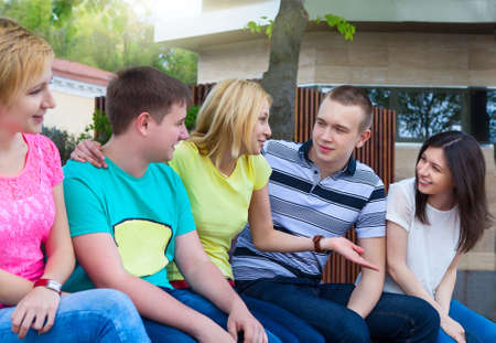 freshmen: Group of smiling teenagers outdoors. Friendship concept