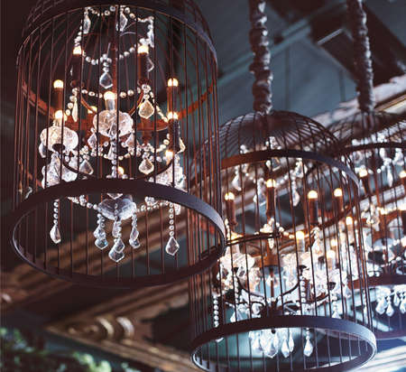 Chrystal chandeliers close-up. Glamour background with copy space photo