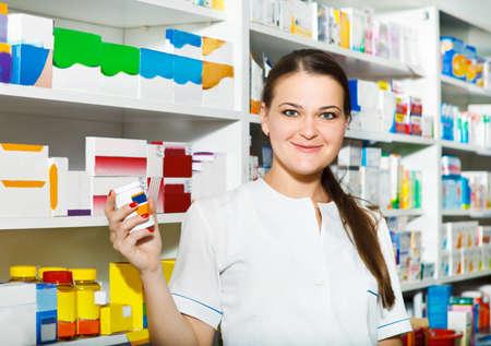 Portrait of female pharmacist at the drugstore photo