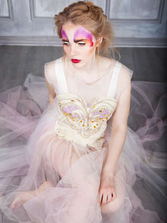 Young model beautiful woman with perfect butterfly make up and hairstyle