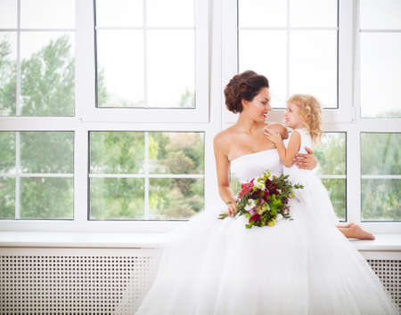bare feet girl: Smiling happy bride and a flower indoors. Horizontal shot