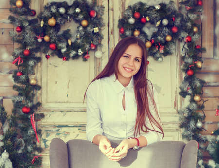 cute teen girl: Happiness and holidays concept. Smiling teenage girl having fun over christmas decoration background Stock Photo