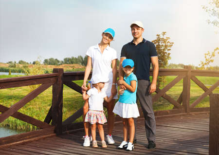 country club: Portrait of a happy young family in golf country club