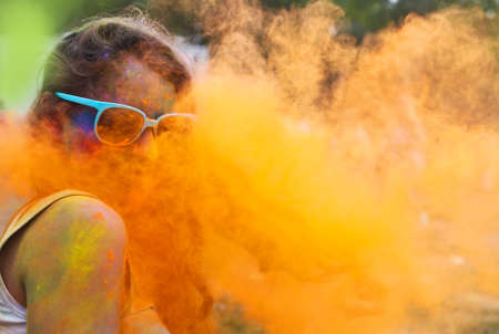 spring festival: Portrait of happy young girl on holi color festival