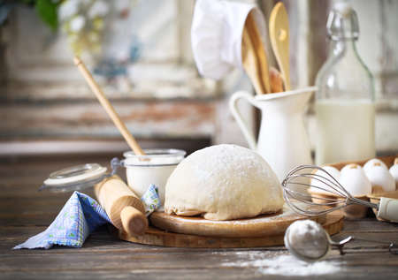 utensil: Ingredients for dough on white wooden table. Close up