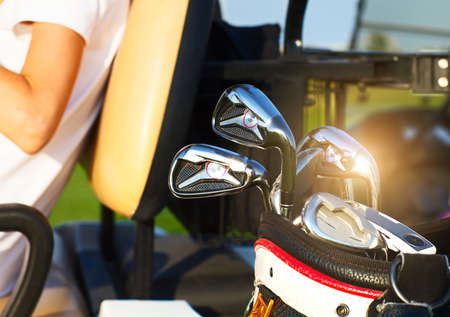 Close up of professional golf gear on the golf course at sunset