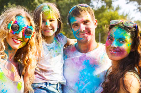 Portrait of happy friends on holi color festival