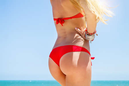 young bikini: Beautiful young woman in sexy bikini at the beach Stock Photo
