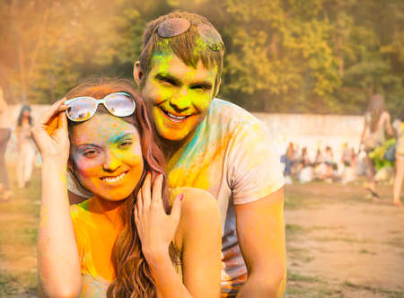 colorized: Portrait of happy couple in love on holi color festival Stock Photo