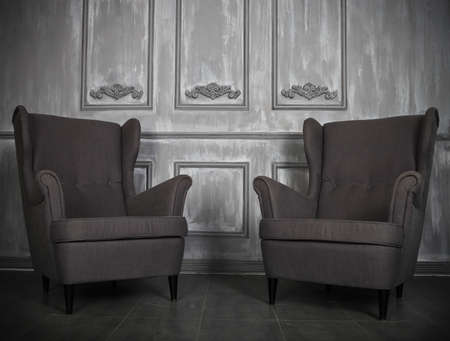 luxurious background: Two classic armchairs against a gray wall and floor. Copy space Stock Photo