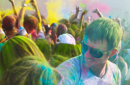worshipers: Portrait of a young smiling man on holi color festival