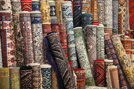 Many colorful carpets in the store. Background photo
