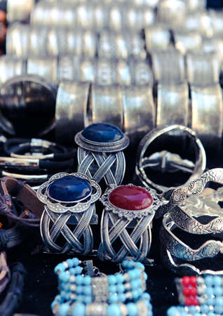 Traditional metal bracelets on the market of Tunisia. Background photo