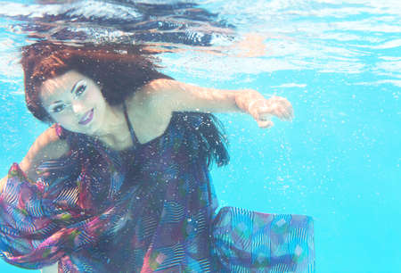 wet dress: Underwater woman close up portrait in swimming pool Stock Photo