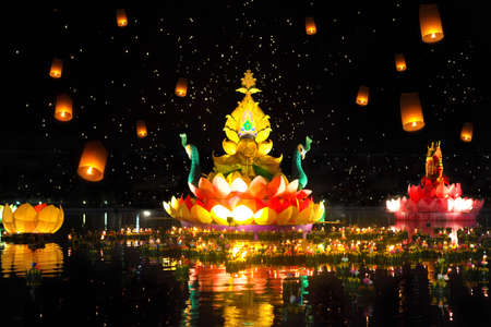 Big and small boats with candles and flowers are given for Thailands traditional Loy Krathong Festival. Sky lanterns in the sky