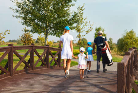 woman golf: Happy young family in golf country club