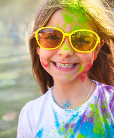 worshipers: Portrait of happy cute litttle girl on holi color festival