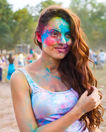 worshipers: Portrait of happy young girl on holi color festival
