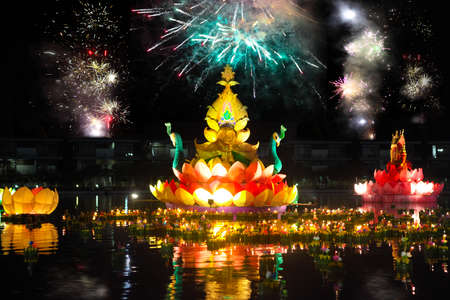 Big and small boats with candles and flowers are given for Thailands traditional Loy Krathong Festival. Fireworks in the sky