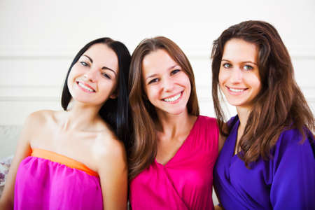young girl: Three happy female teen girls having fun together