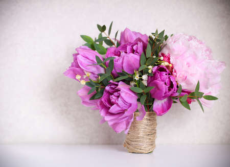 pion: Wedding bouquet of a pink peonies, tulips and lily of the valley