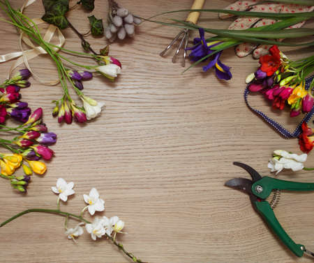 arranging: Florist workplace with copy space: flowers and accessories Stock Photo