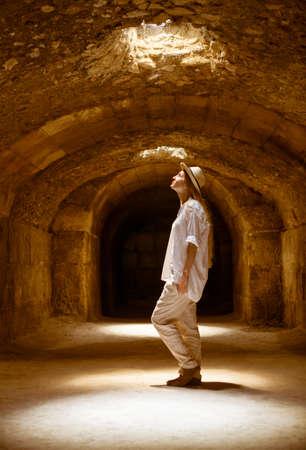 dungeons: Woman in Tunisia El Jem roman apmphitheatre. Largest colosseum in in North Africa. El Jem,Tunisia.