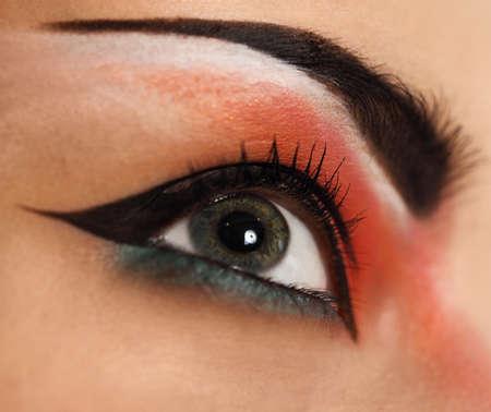 Eye make up. Beautiful eyes glitter make up. Holiday makeup detail photo