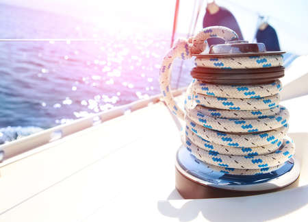 rigging: Sailboat winch and rope yacht detail. Yachting Stock Photo