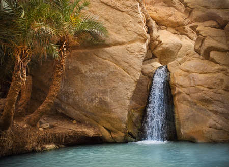 View of mountain oasis Chebika with waterfall, Sahara desert, Tunisia, Africa