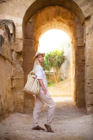 dungeons: Woman in Tunisia El Jem roman apmphitheatre. Largest colosseum in in North Africa. El Jem,Tunisia. UNESCO Stock Photo