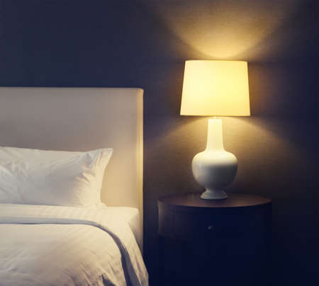 bed linen: Abstract hotel bedroom with lamp and hotel bed with space for text