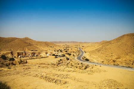 View of mountain road in Sahara desert, Tunisia, Africa photo