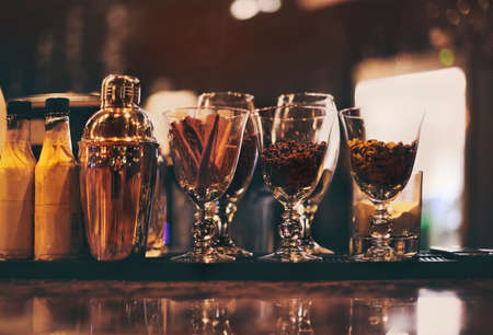 Classic bar counter with bottles in blurred background