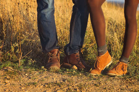 adult foot: Couple man and woman feet in love romantic outdoor with autumn season nature on background. Fashion trendy style Stock Photo