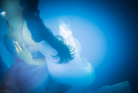 underwater woman: Underwater woman close up in swimming pool Stock Photo